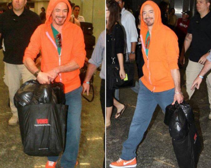 Quando desembarcou no Brasil, Robert Downey Jr. até que tentou não ser reconhecido. E escolheu um moletom com capuz para disfarçar
