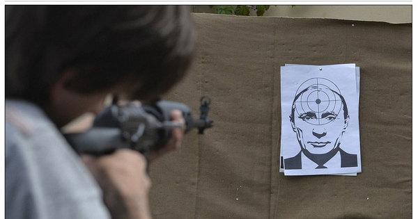 """""""Meca anti-Putin"""": cidade ucraniana tem rosto do líder russo ..."""