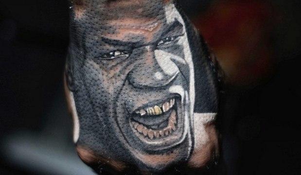 Rapper brigão tatua rosto de Mike Tyson na mão. Veja outras tatuagens inusitadas de fãs