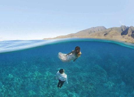 Fotógrafos fazem imagens incríveis de noivos debaixo d'água