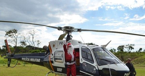 Papai Noel usa helicóptero da Polícia do DF para entregar ...