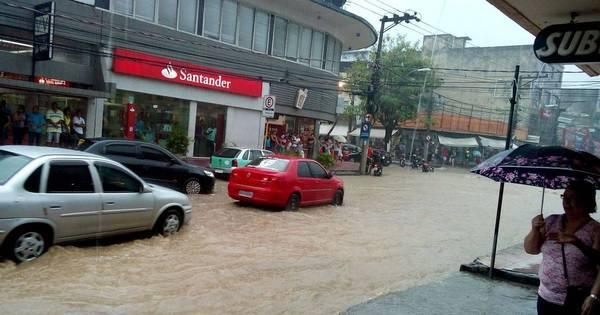 Rio entra em atenção para chuvas e registra pontos de alagamento ...