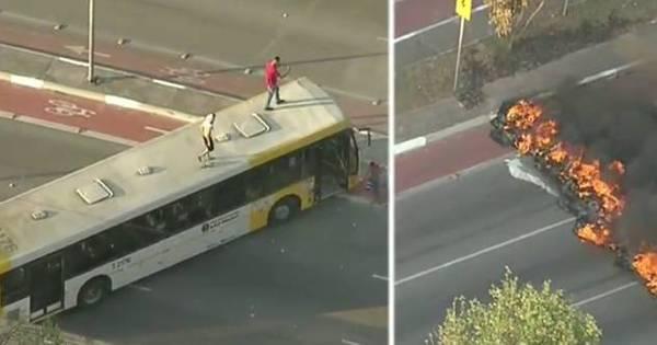 Manifestantes ateiam fogo em pneus e depredam ônibus na zona ...
