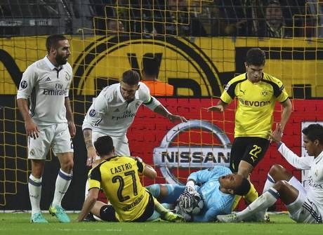 Em noite de inspirada de Navas, Real fica no empate com Borussia
