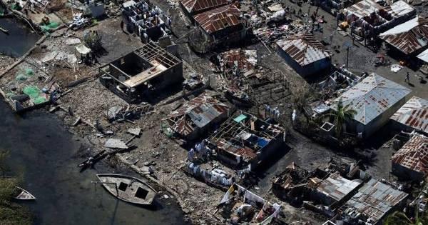 Número de mortos pelo furacão Matthew no Haiti sobe para mil ...