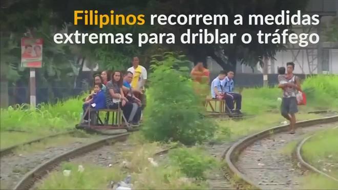 Para fugir do trânsito filipinos arriscam vida em trilhos de trem
