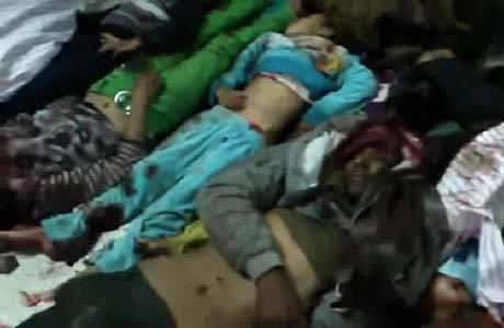 Imagem retirada de um vídeo publicado hoje no Youtube mostra corpos das vítimas do atentado que matou 20 pessoas em Raqqa
