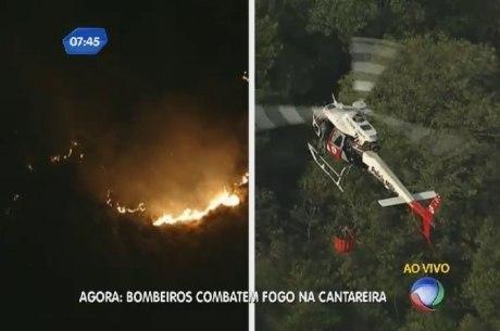 Fogo atinge parque estadual da Cantareira e bombeiros usam cesto para buscar água e jogar nos focos de incêndio