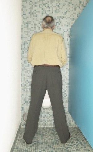 sintomas de prostata aumentada em caes