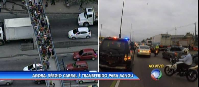 População lotou viadutos da avenida Brasil para acompanhar comboio que levava Cabral para penitenciária de Bangu