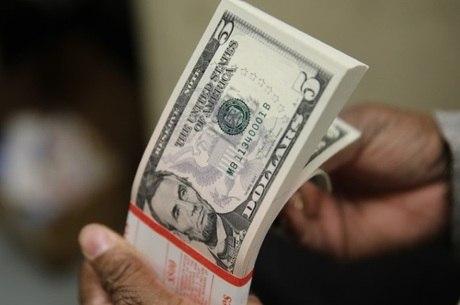 5180db2cad Tire 8 dúvidas sobre compra de dólar e outras moedas para viajar ...