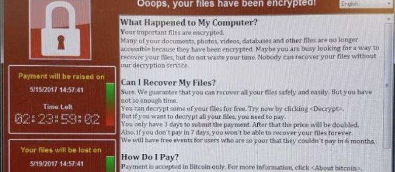 Tela mostra aviso de que dados de computador foram bloqueados por vírus, em hospital do Reino Unido