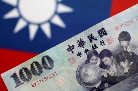 A medida pode irritar Pequim, na foto, nota de moeda taiwanesa