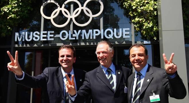 O ex-prefeito do Rio Eduardo Paes, Nuzman e Cabral, na votação da cidade-sede