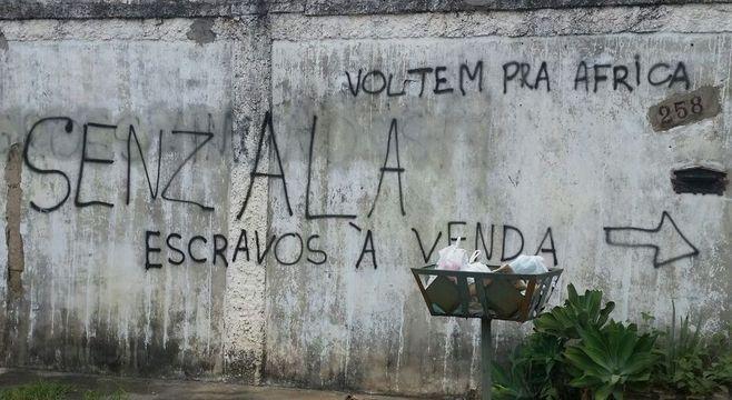 Nova pichação feita em muro da vítima sobre antiga, que foi pintada