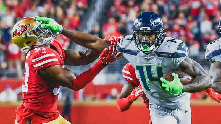 6. DK Metcalf (Seattle Seahawks): A ascensão meteórica do wide receiver dos Seahawks é assustadora para cornerbacks e coordenadores defensivos ao redor da NFL. Esnobado por toda a NFL no draft de 2019, ele vem mostrando evolução em suas rotas, muita força em recepções contestadas e muita velocidade. Em 2020, com 1303 jardas e 10 TDs, ele foi eleito Second-team All-Pro, além de ser indicado para o Pro Bowl.