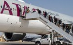 In this image released by the US Central Command Public Affairs, US Embassy personnel from Afghanistan board a Qatar Airways flight to Kuwait as part of Operation Allies Refuge on August 17, 2021, at Al Udeid Air Base, Qatar. Noah Coger / US Central Command (CENTCOM) / AFP