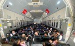 This handout photo taken on August 18, 2021 by the Turkish Defence Ministery Press Service and released on August 19 shows Turkish citizens on A400 M type transport aircraft of the Turkish Air Forces during evacuation of Turkish citizen in Kabul international Hamid Karzai airport. The Taliban fighters took control of Kabul on August 15 after a lightning offensive that saw the former government's provincial strongholds around the country topple like dominoes in a matter of days. Handout / TURKISH DEFENCE MINISTRY / AFP