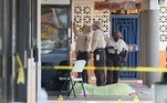 HIALEAH, FLORIDA - MAY 30: Miami-Dade police investigate near shell case evidence markers on the ground and a door with what appear to be bullet holes where a mass shooting took place outside of a banquet hall on May 30, 2021 in Hialeah, Florida. Police say that two people died, and an estimated 20 to 25 people are injured after the shooting at the banquet hall rented out for a concert. Joe Raedle/Getty Images/AFP JOE RAEDLE / GETTY IMAGES NORTH AMERICA / Getty Images via AFP