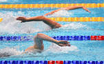 Great Britain's Tamryn Van Selm (front) competes in a heat for the Women's 4x200m Freestyle Relay Swimming event during the LEN European Aquatics Championships at the Duna Arena in Budapest on May 21, 2021. Attila KISBENEDEK / AFP