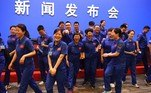 Staff members of the Jiuquan Satellite Launch Centre share a light moment following a briefing the day before the launch, at the Jiuquan Satellite Launch Centre in the Gobi desert, in northwest China on June 16, 2021. Greg BAKER / AFP