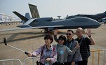 CHINA-AIRSHOW-ZHUHAI Visitors take photos in front of a People's Liberation Army Air Force (PLAAF) WZ-7 high-altitude reconnaissance drone at the 13th China International Aviation and Aerospace Exhibition in Zhuhai in southern China's Guangdong province on September 28, 2021. Noel Celis / AFP