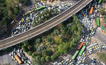 This aerial picture taken on March 25, 2021 shows a congested roundabout in New Delhi, as India recorded more than 50,000 new coronavirus cases for the first time since November while a new wave of infections takes hold a year after one of the world's tightest Covid-19 lockdowns was imposed. Prakash SINGH / AFP