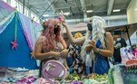 Mermaids shop for accessories for their outfits during MerMagic Con at the Freedom Aquatic Center in Manassas, Virginia on August 7, 2021. MerMagic Con is advertised as the largest Mermaid convention in the world. Some parts of the convention are based on modeling and looks like the Miss Mermaid USA Pageant. The Society of Fat Mermaids looks to bring together plus size people and promote the idea that anyone can become a mermaid. Becoming a mermaid is not cheap, most merfolk spend thousands of dollars on their tail and outfit. Most tails are custom made out of silicone and others are foam and fabric. Joseph Prezioso / AFP