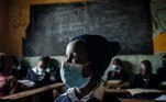 Students of Miracle and Victory Children Centre, a private primary school for orphans, attend a class as schools reopen after a 6 weeks break following the directive by Kenyan President Uhuru Kenyatta's to curb the spread of the Covid-19 coronavirus, in Kibera slum, Nairobi, on May 10, 2021. Yasuyoshi CHIBA / AFP