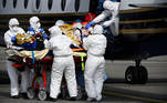 Medical staff use a gurney to carry a patient infected with Covid-19 from a medical plane to an helicopter as part of his transfer from Nice, where intensive care units are overloaded with Covid-19 patients on March 16, 2021 in Toulouse-Blagnac. Lionel BONAVENTURE / AFP