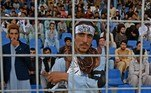 A Taliban fighter stands guard as spectators watch the Twenty20 cricket trial match being played between two Afghan teams 'Peace Defenders' and 'Peace Heroes' at the Kabul International Cricket Stadium in Kabul on September 3, 2021. Aamir QURESHI / AFP