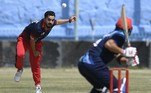 A Peace Heroes team player (L) bowls during the Twenty20 cricket trial match being played between the two Afghan teams 'Peace Defenders' and 'Peace Heroes' at the Kabul International Cricket Stadium in Kabul on September 3, 2021. Aamir QURESHI / AFP