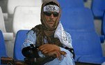 A Taliban fighter watches the Twenty20 cricket trial match being played between two Afghan teams 'Peace Defenders' and 'Peace Heroes' at the Kabul International Cricket Stadium in Kabul on September 3, 2021. Aamir QURESHI / AFP