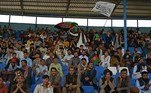 Spectators wave Afghanistan's and Taliban flags as they watch the Twenty20 cricket trial match being played between two Afghan teams 'Peace Defenders' and 'Peace Heroes' at the Kabul International Cricket Stadium in Kabul on September 3, 2021. Aamir QURESHI / AFP
