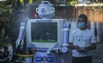 Aseyan, who goes by one name only, operates a disinfection robot named Delta, which he created from recycled household goods, at a neighbourhood in Surabaya on July 28, 2021. Juni Kriswanto / AFP