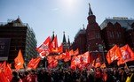 Russian communist members and supporters walk with red flags at Manezhnaya Square during the celebration of International Workers' Day in Moscow on May 1, 2021. Dimitar DILKOFF / AFP