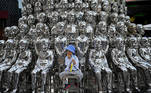 A boy sits on a chair amongst sculptures on display at a shopping centre on International Children's Day in Beijing on June 1, 2021, a day after China announced it would allow couples to have three children. Noel Celis / AFP