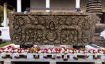 An ancient sandstone lintel, a sacred late 10th or 11th century sandstone support beam, is pictured at the Bangkok National Museum during an event to mark their return from the United States to Thailand, in Bangkok on May 31, 2021. Jack TAYLOR / AFP
