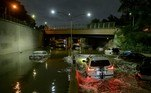 Floodwater surrounds vehicles following heavy rain on an expressway in Brooklyn, New York early on September 2, 2021, as flash flooding and record-breaking rainfall brought by the remnants of Storm Ida swept through the area. Ed JONES / AFP