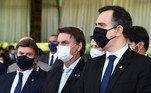 Brazilian President Jair Bolsonaro (C), Supreme Court President Luiz Fux (L) and National Congress Rodrigo Pacheco attend a press conference after meeting with the heads of the three government branches and their ministers to discuss possible solutions for the COVID-19 pandemic crisis that is plaguing the country, at the Alvorada Palace in Brasilia, on March 24, 2021. Brazil's daily Covid-19 death toll soared past 3,000 for the first time on the eve, as the hard-hit country struggled to contain a surge of cases that has pushed many hospitals to breaking point. EVARISTO SA / AFP