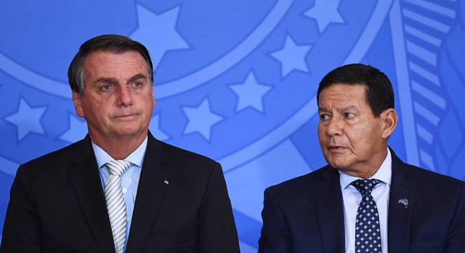 O presidente Jair Bolsonaro e o vice, Hamilton Mourão, em evento em Brasília