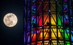 The almost full moon is seen next to the Tokyo Skytree in Tokyo on April 26, 2021. Philip FONG / AFP