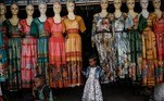 A girl touches a dress that is for sale at the Monday Market, open once a week along the streets on Monday, in Mekele, the capital of Tigray region, Ethiopia, on June 21, 2021. Yasuyoshi CHIBA / AFP