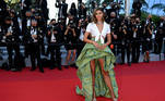 """US model Taylor Hill poses as she arrives for the screening of the film """"Tre Piani"""" (Three Floors) at the 74th edition of the Cannes Film Festival in Cannes, southern France, on July 11, 2021. CHRISTOPHE SIMON / AFP"""