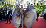 """A guest arrives for the screening of the film """"De Son Vivant"""" (Peaceful) at the 74th edition of the Cannes Film Festival in Cannes, southern France, on July 10, 2021. CHRISTOPHE SIMON / AFP"""