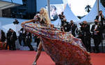 """A guest arrives for the screening of the film """"La Fracture"""" (The Divide) at the 74th edition of the Cannes Film Festival in Cannes, southern France, on July 9, 2021. Christophe SIMON / AFP"""