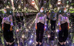 A visitor poses as she stands in an optical illusion installation, at the Illusion Museum in Arbil, the capital of Iraq's northern autonomous Kurdish region, on April 26, 2021. SAFIN HAMED / AFP