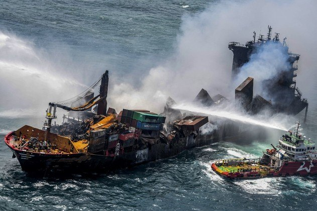 This handout photograph taken and released by the Sri Lanka Air Force on May 30, 2021 shows smoke billowing from the Singapore-registered container ship MV X-Press Pearl, which has been burning for the eleventh consecutive day as vessels try to douse off the fire, in the sea off Sri Lanka's Colombo Harbour, in Colombo. SRI LANKA AIR FORCE / AFP