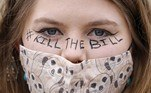 """A demonstrator taking part in a 'Kill The Bill' protest against the Government's Police, Crime, Sentencing and Courts Bill is seen with """"Kill The Bill"""" written on her face at Hyde Park in central London on April 3, 2021. The police, crime, sentencing and courts bill would give police in England and Wales more power to impose conditions on peaceful protests, including those they deem to be too noisy or a nuisance to the community. Critics argue this infringes on the right to free and peaceful expression. Tolga Akmen / AFP"""