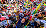 THAILAND-MYANMAR-POLITICS-MILITARY Myanmar migrants in Thailand shout slogans at a protest against the military coup in their home country, in front of the United Nations ESCAP building in Bangkok on March 7, 2021. Mladen ANTONOV / AFP
